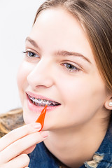 Dental Health Ideas and Concepts.Closeup Portrait of Caucasian Female Teenager With Teeth Braces. Cleaning Brackets Using Bristle Brush. (DmitryMorgan) Tags: 1 1319years attractive blond brace bracket brackets caucasian closeup correction cure cute dent dental dentin dentistry detail equipment female fix girl health human indoors interdental jaw medicine metal model mouth oral oralcare ortho orthodontic orthodonture pretty repair smiling smoothing straight teen teenager teeth tilted tool tooth toothbrush treatment white wire young