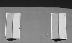 L'estate è alla finestra - Summer waits on the side-lines (Lorenzo BC-1) Tags: estate summer luce light finestre windows bianco white nero black monocromo monochrome canon ombra shadow muro wall chiaro bright dark scuro