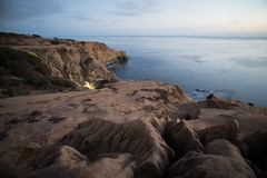 Sunset Cliffs Long Exposure (Photos By Clark) Tags: northamerica california location canon2470 canon5div unitedstates cities sandiego locale places where us longexposure pacific lightroom water waves cliffs bluff erosion soil texture fire light calm blue brown afterdark thesandiegoist