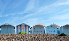 Singled out (John (Thank you for >2 million views)) Tags: 7dwf freetheme beachhuts blue shingle skyline bluesky stripes blueandwhite rustingtonbeach rustington ukcoast ukcoastline sussex