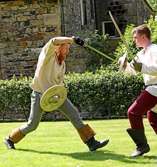The Red Wyverns at Skipton Castle (grab a shot) Tags: canoneos5dmarkiv canon eos 5d britain uk england northyorkshire skipton skiptoncastle 2018 heritage medieval castle 1460 henryvi lordjohnclifford redwyvernsociety historical reenactment warsoftheroses hundredyearswar fifteenthcentury livinghistory war man soldier military sword fighting shield