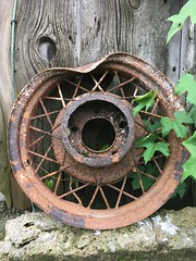 Just a Small Dent (arrjryqp6) Tags: texture ruraldecay rural bentanddented spokes decay rusting rusted rust bentrim rim wheel