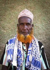 Portrait of muslim man with henna tinted beard, Afar region, Assayta, Ethiopia (berengere.cavalier) Tags: 1people abyssinia adult adults africa african asaita asayta assaita assayta beard blackethnicity blackpeople blackskin cap color danakil day eastafrica ethio16351 ethiopia ethiopian ethnicity etnic etnicgroup hat henna hornofafrica lookingatcamera men old oldmen onemanonly oneperson onlymen outdoor outdoors red redbeard senior seniormen tinted tradition traditional tribal tribe vertical afarregion