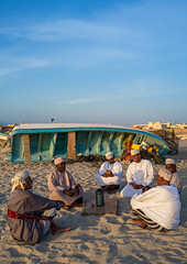 Omani men resting and drinking tea on the beach at sunset, Dhofar Governorate, Mirbat, Oman (Eric Lafforgue) Tags: adults adultsonly arabia arabianpeninsula boat colorimage community conversation copyspace dhofar dishdasha drinking friendship groupofpeople gulfcountries men menonly middleeast mirbat moscha oldmen oman oman18409 omani outdoors sand sit sultanate talking tea together togetherness traveldestination vertical dhofargovernorate