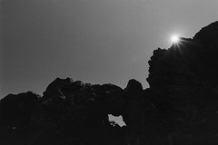In the heights. (Ojo de Piedra) Tags: neopan400 landscape nature mountains 35mmfilm film mexico negativefilm monochrome travel shapes sunstar nikonf100 filmslr blackwhite nikon barren