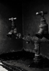 Time. (ianmiller6771) Tags: taps leaky water metal waterdroplets blackwhite monochrome fuji 35mm waterpipe dark mood time gloom allegorical metaphor