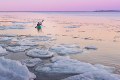Man peacefully kayaking alone in icy Ontario lake (blurMEDIA Stock) Tags: brucepeninsula canada earth georgianbay ontario pfd active carpediem challenge climate climatechange determination environment environmental exercise fitness frozen fun globalwarming goodlife happy health healthy ice icy journey kayak kayaking lake lifejacket lifestyle living north northern outdoor perserverance planet refreshing rejuvenation relaxation retreat safety seasons skill solitary solitude sport warming winter wintersport