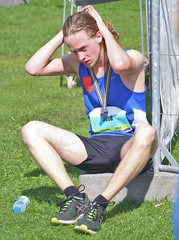 IMG_5250 (Skinny Guy Lover) Tags: outdoor people candid guy man male dude sitting sit seated longhair shorts blackshorts sportsshorts tanktop sportclothes runner athlete medal handsome handsomeguy