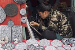 0767 A Souvenir Maker (Hrvoje Simich - gaZZda) Tags: people woman portrait work job souvenirs stonework art market kathmandu nepal asia travel nikon nikond750 nikkor283003556 hrvojesimich gazzda
