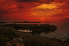 peaceful hours (s_gulfidan) Tags: sky sunset boats lake water landscape grass 300faves