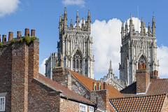Above the rooftops (phdlou) Tags: york yorkminster minster church cathedral houseofworship religion rooftop rooftops roofs tiles orange blue clouds spire spires chimney chimneys
