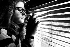 What is she waiting for? (GeoMatthis) Tags: portrait porträt black blackandwhite blackwhite bw grau white light shadow lines contrast sun schwarz schwarzweis schwarzundweis weis gray licht schatten linien diagonalen diagonal kontrast menschen mädchen people urban city street