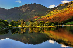 Golden Buttermere (images@twiston) Tags: golden buttermerepines thebuttermerepines buttermere pines borrowdale lake cumbria lakedistrict haystacks boathouse fishing char hut lakeland trees tree view scenic thelakes lakedistrictnationalpark nationaltrust fell fells mountains landscape imagestwiston district national park countryside mountain sunlit sunshine still water reflection reflections morning mirror autumn green greens englishlakedistrict lakes thelakedistrict reflected waterreflections sunrise dawn lonehouse calm serene goldenlight warm shore shoreline northlakes iconic polarizer cpl goldenhour backlight backlit sentinels sentinel blue sky cloud clouds unesco worldheritagesite