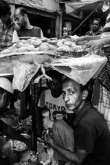 Stare (Shahrear94) Tags: blackandwhite street bnw canon monochromatic flash 18mm blackwhite frame flicker bangladesh contrast dhaka iftar bazar ramadan monochrome memory moment tradition light highlighted