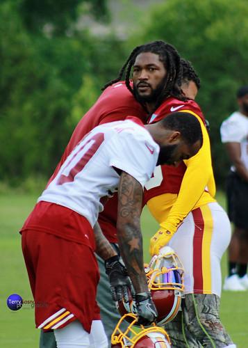 Redskins players DJ Swearinger Sr. and Paul Richardson Jr. on sidelines during practice.