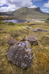 Rhyd Ddu Path (John Joslin) Tags: hill mountain rocks rock clouds landscape wales snowdonia lake water grass grassland summer spring hiking remote a7rii colour daylight field flora hills loxia2821 loxia light mountains nature natural outdoors outside rural sony sky uk