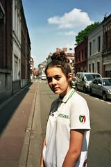Leya (michel nguie) Tags: michelnguie film analog portrait girl kid teen youth rbx roubaix rueducollege street vertical sky clouds