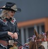 Cowgirl Dressed In Black (Scott 97006) Tags: woman girl female blonde equestrian horse animal ride parade beauty