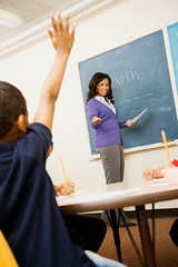 Stock Images (perfectionistreviews) Tags: 2 20s adult africanamerican answer answering black boy brunette chalkboard cheerful child class classroom education educator elementaryschool female grinning happiness happy indoors inside kid male people person question selectivefocus smile smiling student teacher teaching threequarter tilt tiltview tilted tiltedview twenties two woman young color photograph vertical childhood children