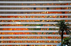 Mystère in Mirage (studioferullo) Tags: abstract architecture art beauty bright building colorful colourful colors colours contrast dark design detail downtown edge light minimalism outdoor outside perspective pattern pretty scene study sunlight sunshine street texture tone world strip lasvegas nevada mirage mystere reflection glass lines tree sign