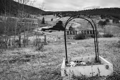 Central City - Historic Cemetary - Baby Sonne and Toys In Front of Mine - B and W (ImNotDedYet) Tags: cemetary tombstone child centralcity colorado mill road forest blackwhite monochrome blackandwhite