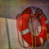 Flotation Device (Barb Henry) Tags: safety device lifesaver flotation ship ropes orange grunge saving help