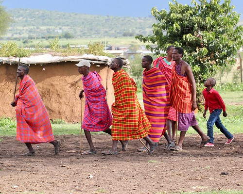 Maasai start a welcome dance
