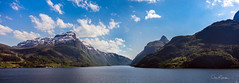 The Splendour of the Fjords (clive_metcalfe) Tags: norway norwegian fjords fredolsen water sky blue clouds forest houses village