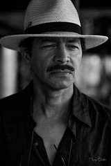 Colonel Luis Cruz [Stranger #80/100] (Vijay Britto Photography) Tags: man handsome hat cowboy 85mm 18 stern colonel seriou nikon d750 100strangers naturallight outdoorportraits