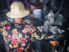 Vung Tau 02 (arsamie) Tags: vungtau vietnam south cap saint jacques woman worker flowers banh khot maker food kitchen pouring flame fire bbq barbecue oil fried deep