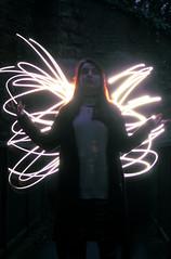 Free. (cbathonewton) Tags: portrait night slowshutter light dark nightime blue lighttrails people street surreal angel magic wings