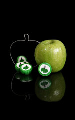 2018 Sydney: Apples (dominotic) Tags: 2018 food fruit apple confectionery applebiscuitcutter applelolly grannysmithapple green reflection blackbackground circle sydney australia