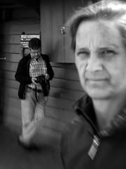 Missed Shot (Anne Worner) Tags: anneworner bw blackandwite camera candid close man mono people photographer silverefex street streetphotgraphy woman candidstreetphotography lensbaby composerpro sweet35 blur bend manualfocus manualfocuslens selectivefocus bryggen bergen olympus outdoors outside availablelight jeans jacket shirt digitalcamera zoomlens longlens
