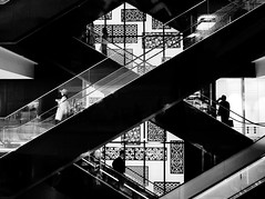 Intersection of life (明遊快) Tags: urban building contrast monochrome people japanese lines dark lights bw elevated walkway architecture silhouette pattern happyplanet asiafavorites
