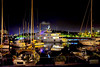 Barceloneta - The tip: Don't go down there without... (Fnikos) Tags: port porto puerto harbour harbor sky skyline sea water waterfront light reflection moll muelle boat sailboat ship barco street vehicle night nightview nature outdoor