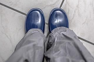 Rubber boots under pants