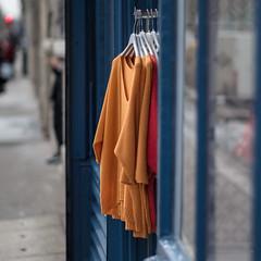 Orange, or red? Quai de Valmy - Paris (Paul Perton) Tags: france fuji56mmf12 paris xpro2 candid orange red shop square street streetphotography urban