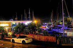 Barceloneta, the other corner. (Fnikos) Tags: port porto puerto harbour harbor sea water waterfront boat sailboat street road vehicle night nightview tree palmtree nature people outdoor