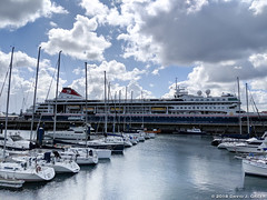 At the Marina (David J. Greer) Tags: a coruna la galicia spain winter rubicon3 sailtrainexplore morning blue sky cloudy marina cruise ship boats sailboats docks masts real club nautico náutico