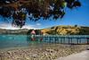 Blue Waters (Jocey K) Tags: bankspeninsula newzealand nikond750 akaroa akaroaharbour sea hills landscape boats yachts pier building stones seashore trees sky clouds
