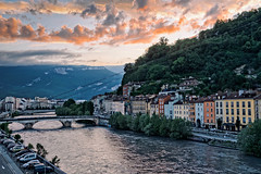 Sunset over the river (Luca Quadrio) Tags: view france water scenic building sunset travel alps isere tourism city cityscape panorama hill town sky skyline sun blue urban outdoors grenoble river forest house outdoor architecture beautiful landscape europe landmark mountain auvergnerhônealpes francia fr