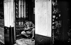 (Mister G.C.) Tags: street urban photography blackandwhite bw leica leicamini leicaminiii elmar f35 primelens fullframe compactcamera compact camera autofocus autofocusing streetphotography urbanphotography shot image photograph candid people man male guy phone mobile cellphone handy gritty crouching monochrome town city analog analogphotography analogue 35mm film filmcamera schwarzweiss strassenfotografie mistergc glasgow scotland europe kodak gold 200