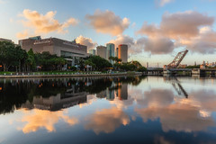 Beautiful Clouds Reflected at Sunrise from Julian Lane Park in Tampa (Photomatt28) Tags: beercan effects florida hillsboroughriver reflection rivergatebuilding skyline strazcenterfortheperformingarts sunrise sykesbuilding tampa unitedstates us