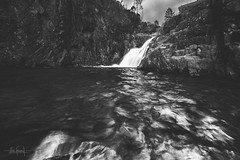 The path trails off and I don't know where it leads (RuiFAFerreira) Tags: bw black wide white waterscape canon dark efs1018mmf4556isstm exterior landscape longexposure mood nature portugal national park river shadow light uwa water waterfall rocks