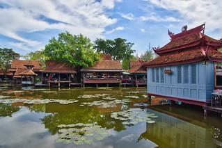 Lake and historic village replica in Muang Boran (Ancient Siam) in Samut Phrakan near Bangkok, Thailand