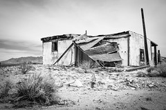 Rock Tank, Mojave National Preserve, California (paccode) Tags: solemn d850 sand landscape desert bushes brush blackwhite quiet california abandoned barn monochrome farm mojave creepy forgotten nationalpark scary serious unitedstates us