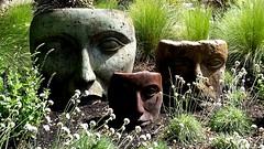 Garden Faces (SqueakyMarmot) Tags: canada britishcolumbia bc vancouverisland victoria yard garden sculptures art