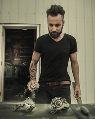 In Frankford. (pedferr) Tags: portrait cinematic fashion 4x5 door male dirty beards outdoors model antique lines usa tattoo mensfashion delaware ink aluminium mechanic selfportrait vintage vehicle paint man shop style metal travel worker rusty painting editorial steel lifestyle unitedstatesofamerica dramatic belt