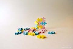 Edible II (Little Hand Images) Tags: candy puzzle pieces interlocking pink blue yellow sweets edible tart food negativespace