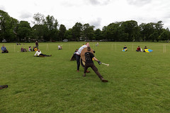 Historia Normannis Meadows June 2018-373 (Philip Gillespie) Tags: historia normannis central scotland sparring fighting shields swords axes spears park grass canon 5dsr men man women woman kids boys girls arms feet hands faces heads legs shins running outdoor tabards chain mail chainmail helmets hats glasses sun clouds sky teams solo dead act acting colour color blue green red yellow orange white black hair practice open tutorial defending attacking volunteer amateur kneeling fallen down jumping pretty athletic activity hit punch
